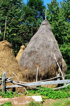 suggestive: Haystack. Village Rosia Montana.  Gold mine Rosia Montana, Transylvania Rosia Montana is a commune of Alba County in the Apuseni Mountains of western Transylvania, Romania.The rich mineral resources of the area have been exploited since Roman times or bef Stock Photo