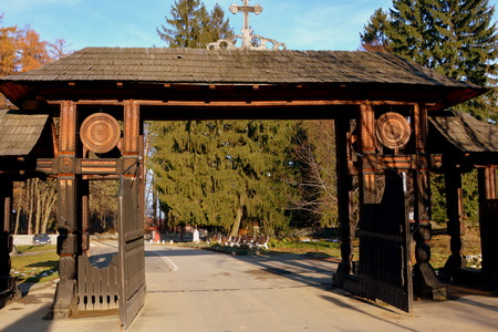 suggestive: Gate. Monastery Sambata is a Romanian Orthodox monastery in Sâmb?ta de Sus, Bra?ov County, in the Transylvania region of Romania. Dedicated to the Dormition of the Mother of God, it is also known as the Brâncoveanu Monastery M?n?stirea Brâncoveanu. Stock Photo
