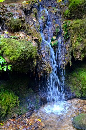 Waterfall. Landscape in Apuseni Mountains, Transylvania The Apuseni Mountains is a mountain range in Transylvania, Romania, which belongs to the Western Romanian Carpathians, also called Occidentali in Romanian. The Apuseni Mountains have about 400 caves. Stock Photo