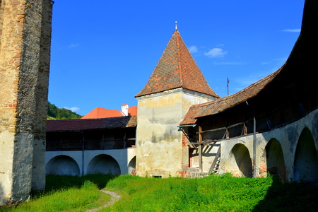 central european: Fortified medieval church in Vineyard Valley, Transylvania Valea Viilor fortified church is a Lutheran fortified church in Valea Viilor (Wurmloch), Sibiu County, in the Transylvania region of Romania. It was built by the ethnic German Transylvanian Saxon  Editorial