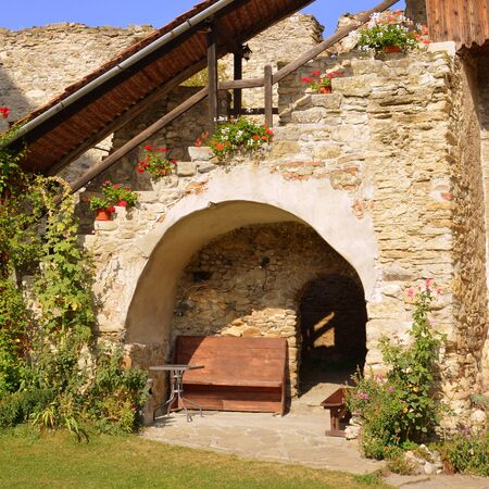 Courtyard of the medieval fortified saxon church in Calnic, Transylvania Câlnic village is known for its castle, which is on UNESCOs list of World Heritage Sites. Câlnic Citadel, first mentioned in 1269, is very well preserved. Built as a nobles resid Stock Photo