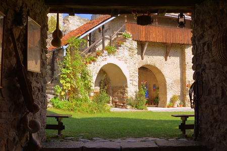 resid: Courtyard of the medieval fortified saxon church in Calnic, Transylvania Câlnic village is known for its castle, which is on UNESCOs list of World Heritage Sites. Câlnic Citadel, first mentioned in 1269, is very well preserved. Built as a nobles resid Editorial