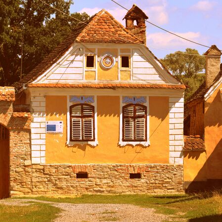 inhabitants: Typical house in the village Crit-Kreutz, Transylvania. The villagers started building a single-nave Romanesque church, which is uncommon for a Saxon church, in the 13th century.