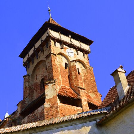 Fortified medieval church in Vineyard Valley, Transylvania Valea Viilor fortified church is a Lutheran fortified church in Valea Viilor (Wurmloch), Sibiu County, in the Transylvania region of Romania. It was built by the ethnic German Transylvanian Saxon  Stock Photo