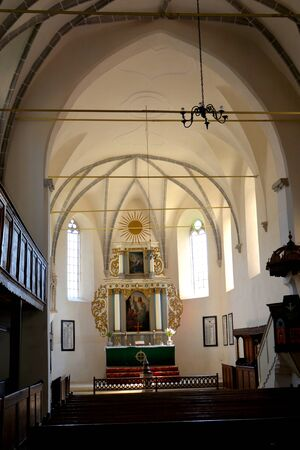 su: Inside the church. Medieval fortified saxon church Saschiz Keisd, Transylvania. The fortified church is a church in Keisd Wurmloch in the Transylvania region of Romania. It was built by the ethnic German Transylvanian Saxon community. Together with the su
