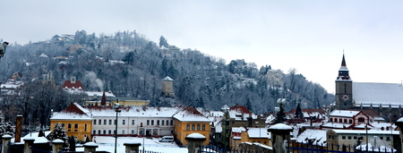 inhabitants: Winter. Typical urban landscape of the city Brasov, Transylvania Brasov is a town situated in Transylvania, Romania, in the center of the country. 300.000 inhabitants. Stock Photo