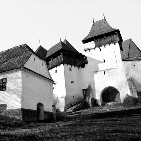 The fortified church in this village was built around 1100 AD. It is part of a area if villages with fortified churches in Transylvania, designated in 1993 as a World Heritage Site by UNESCO Stock Photo