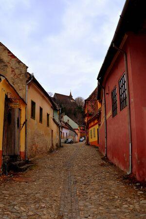 interesting: Medieval city Sighisoara. Urban landscape in the downtown of the medieval city Sighisoara, Transylvania. Stock Photo
