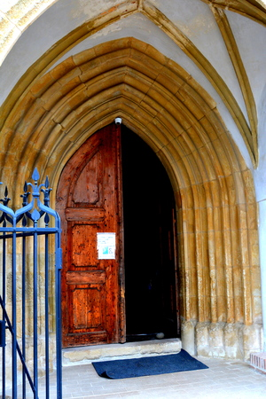 Gate of the Old medieval saxon lutheran church in Sighisoara, Transylvania, Romania Editorial