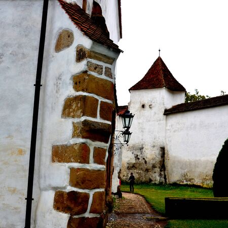 Courtyard of the  Fortified saxon medieval church Harman, Transylvania The villagers started building a single-nave Romanesque church, which is uncommon for a Saxon church, in the 13th century.