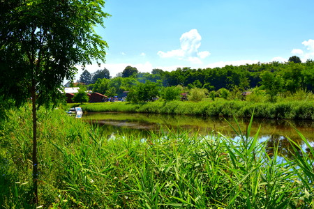 Lake in the transylvanian plain, a summer day and white clound on the blue sky