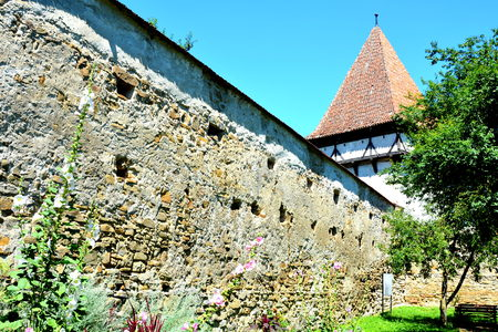 Fortified medieval saxon church in Cincsor-Kleinschenk, Sibiu county, Transylvania, Romania..  The church with a tower on the west is built in 1427. In the middle of the 15th century the first enclosure was erected
