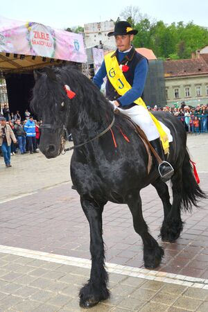 Riders celebrating of the day so call Juni men. A millennial  romanian tradition in Brasov, Transylvania.