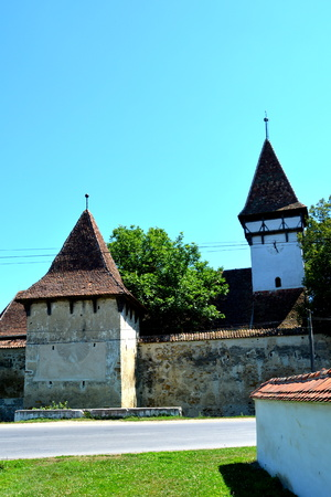 Fortified medieval saxon church in Cincsor-Kleinschenk, Sibiu county.  The church with a tower on the west is built in 1427. In the middle of the 15th century the first enclosure was erected