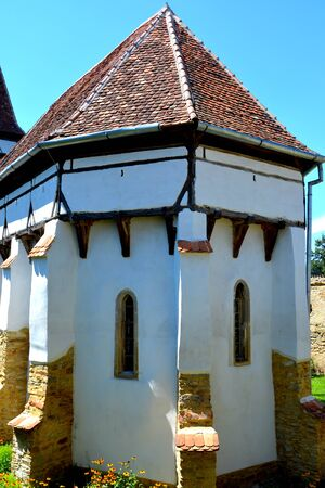 Fortified medieval saxon church in Cinsor-Kleinschenk, Sibiu county.  The church with a tower on the west is built in 1427. In the middle of the 15th century the first enclosure was erected