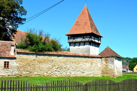 middle: Fortified medieval saxon church in Cinsor-Kleinschenk, Sibiu county.  The church with a tower on the west is built in 1427. In the middle of the 15th century the first enclosure was erected