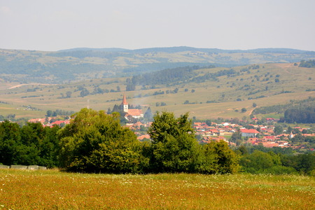 Typical rural landscape and peasant houses in  Bruiu - Braller, a commune in Sibiu County, Transylvania, Romania. The settlement was founded by the Saxon colonists in the middle of the 12th century Stock Photo