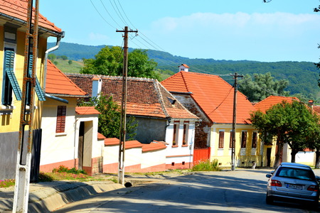 Typical rural landscape in Veseud, Zied, a village in the commune Chirpar from Sibiu County, Transylvania, Romania, first attested in 1379. Peasant houses Stock Photo