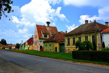 Typical rural landscape and peasant houses in  Dealu Frumos, Schoenberg, a village in Merghindeal commune in Sibiu County, Transylvania, Romania. It was first mentioned in a sale-purchase act dating back to 1280.