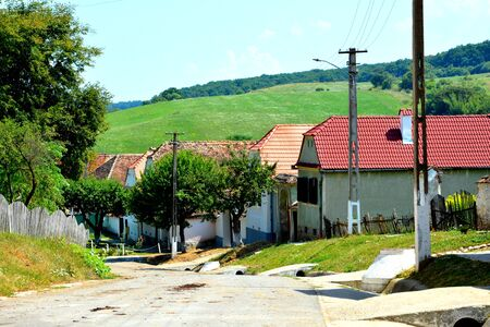 Typical rural landscape and peasant houses in  the village Cobor, Transylvania, Romania. The settlement was founded by the Saxon colonists in the middle of the 12th century