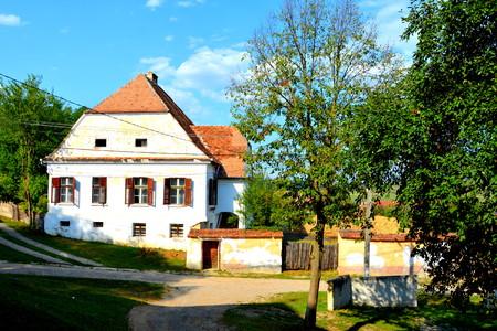 Typical rural landscape and peasant houses in  the village Ticu?u Vechi, Deutsch-Tekes,  the residence village of Ticu? commune in Bra?ov County, Transylvania, Romania. It is the residence of Ticu?u commune.