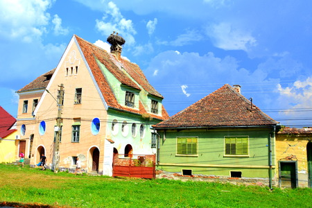 mentioned: Typical rural landscape and peasant houses in  Dealu Frumos, Schoenberg, a village in Merghindeal commune in Sibiu County, Transylvania, Romania. It was first mentioned in a sale-purchase act dating back to 1280.