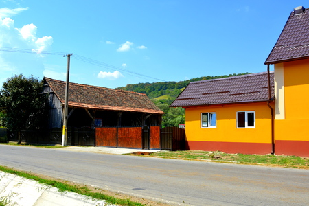 Typical rural landscape in Veseud, Zied, a village in the commune Chirpăr from Sibiu County, Transylvania, Romania, first attested in 1379. Peasant houses. Stock Photo