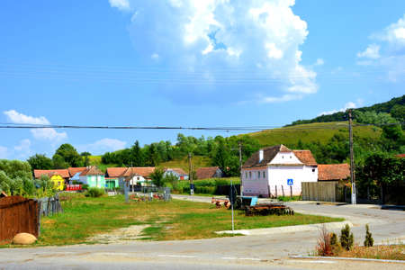 Typical rural landscape and peasant houses in  Vărd,Wierd, Viert, a saxon village in the commune Chirpăr from Sibiu County, Transylvania, Romania. Stock Photo