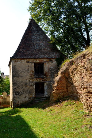 Ruins. Fortified medieval saxon evangelic church in the village Felmer, Felmern, Transylvania, Romania. The settlement was founded by the Saxon colonists in the middle of the 12th century Stock Photo