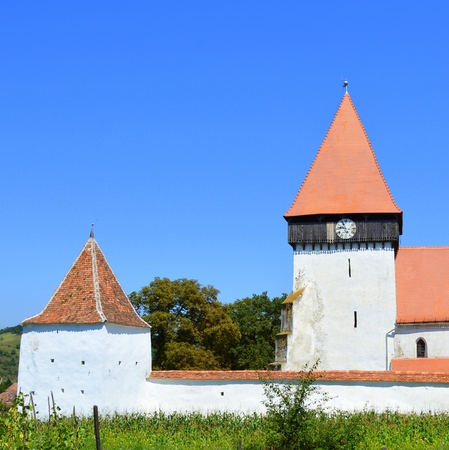 Fortified medieval saxon church in the village Merghindeal- Mergenthal, Transylvania,Romania The settlement was for the first time certified in 1336, but the fortified church dates back to the second half of the 13th century. Stock Photo