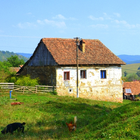 Typical rural landscape and peasant houses in  the village Felmer, Felmern, Transylvania, Romania. The settlement was founded by the Saxon colonists in the middle of the 12th century