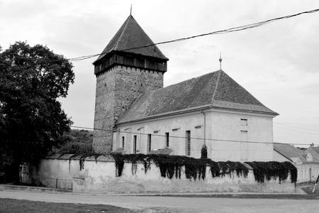 Fortified medieval saxon church in the village Barcut, Bekokten, Brekolten,Transylvania,Romania 스톡 콘텐츠