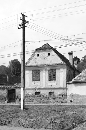 Typical rural landscape and peasant houses in Bradeni, Henndorf, Hegendorf,  Transylvania, Romania. The settlement was founded by the Saxon colonists in the middle of the 12th century