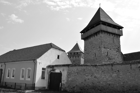 Fortified medieval saxon evangelic church in the village Cata, Transylvania, Romania. The settlement was founded by the Saxon colonists in the middle of the 12th century Stock Photo