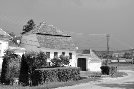 Typical rural landscape and peasant houses in  Dealu Frumos, Schoenberg, a village in Merghindeal commune in Sibiu County, Transylvania, Romania. It was first mentioned in a sale-purchase act dating back to 1280