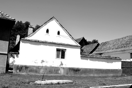 Typical house in the village Ungra, a commune in BraÅŸov County, Romania. In Ungra there is a medieval 13th century Transylvanian Saxon church and many old houses.Since its founding it was one of the most important villages in this area, where there was a strong Transylvanian Saxon community Stock fotó