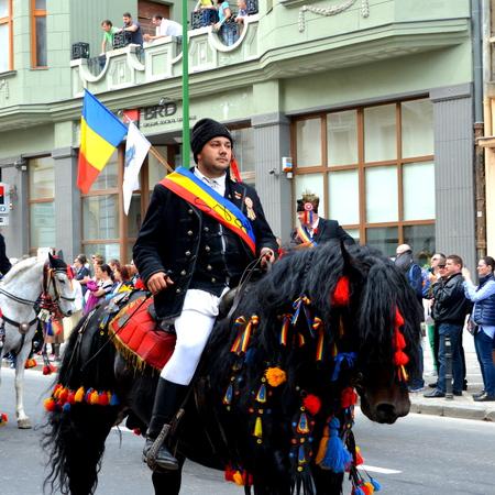 Riders during Brasov Juni parade Riders celebrating of the day so call Juni men. A millennial  romanian tradition in Brasov, Transylvania. Editorial