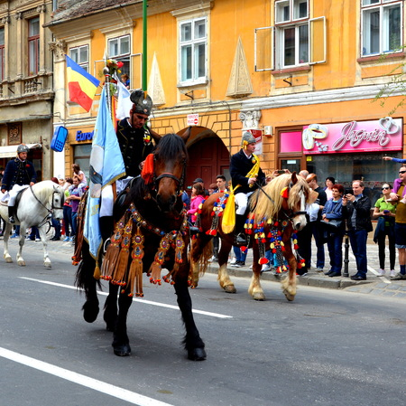 Riders during Brasov Juni parade Riders celebrating of the day so call Juni Parade. A millennial  romanian tradition in Brasov, Transylvania.