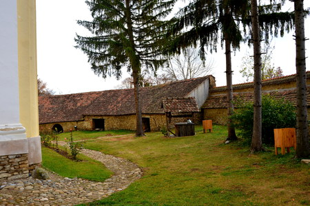 Courtyard of the medieval fortified saxon church in the village Crit-Kreutz, Transylvania, Romania Stock Photo