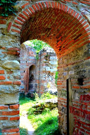 Ruins of an orthodox church in Curtea de ArgeÈ™ (early 16th century). A Romanian Orthodox cathedral. It is located on the grounds of the Curtea de ArgeÈ™ Monastery Stok Fotoğraf