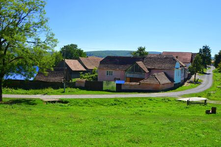 Typical rural landscape and peasant houses in  the village Mesendorf (Meschenderf, Meschendorf, Mesche), Transylvania, Romania. The settlement was founded by the Saxon colonists in the middle of the 12th century