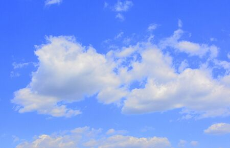 White clouds in a blue sky in a cloudy summer day