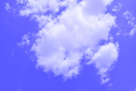 White clouds on blue sky in a cloudy summer day