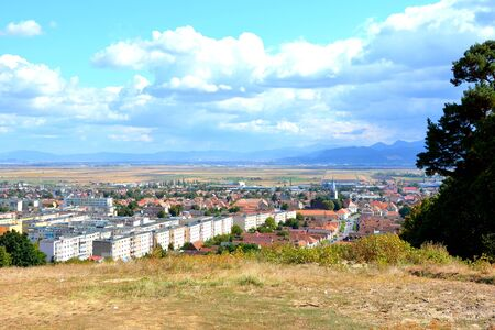 Codlea city. Typical landscape in the forests of Transylvania, Romania. Green landscape in the midsummer, in a sunny day