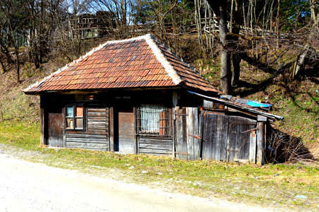 Chalet. Piatra Craiului in Carpathian Mountains, Transylvania. Typical landscape in the forests of  Romania. Green landscape in spring, in a sunny day