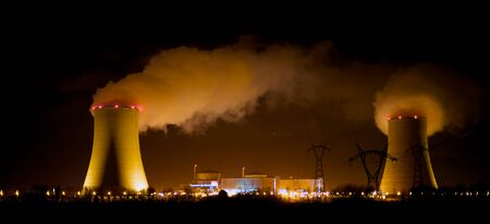 a massive nuclear power plant at night photo