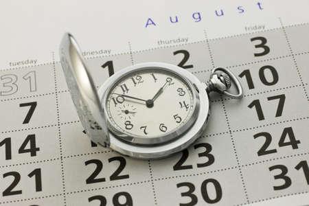 時計とカレンダーのクローズ アップ 写真素材