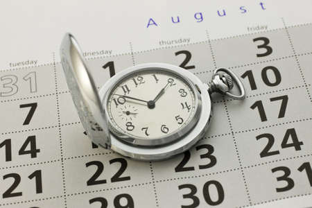 Clock and a calendar close-up Imagens