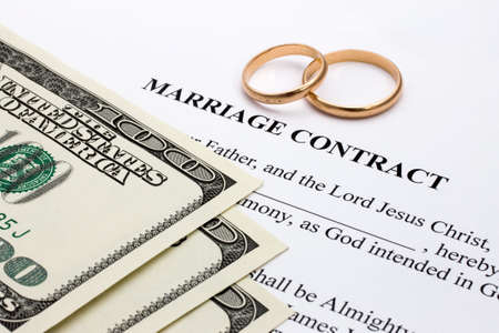 Money and gold rings on the marriage contract