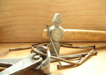 Hammer, pliers and nails photo